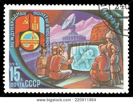 USSR - circa 1981: Stamp printed by USSR, Color edition on Soviet-Mongolian Space Flight, shows Mongolians watching flight on TV, circa 1981
