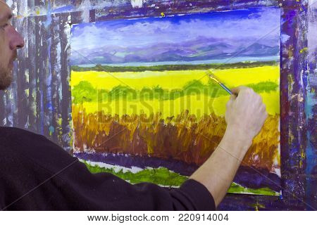 art creative process. Artist create painting with palette knife on canvas