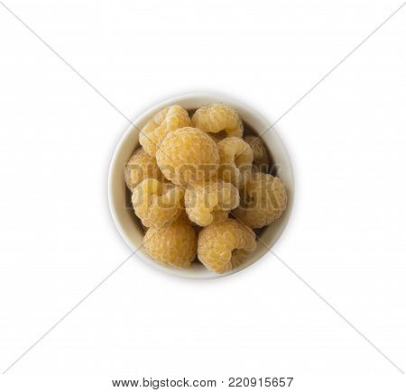 Raspberries in a wooden bowl isolated on white background. Vegetarian or healthy eating. Juicy and delicious yellow raspberry with copy space for text. Top view.