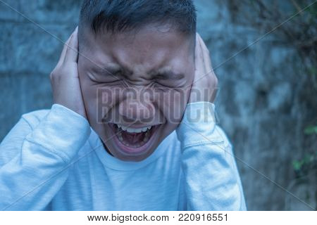 young asian boy scared fear ful alone