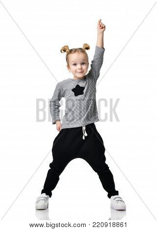 Portrait of young little girl having a brilliant idea pointing finger up isolated on a white background