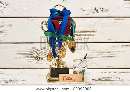 Doping medications and awards. Using enhancing and recreational drugs. Crime in sports and disqualification.