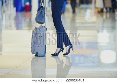 Business Woman With Hand Luggage In An Airport