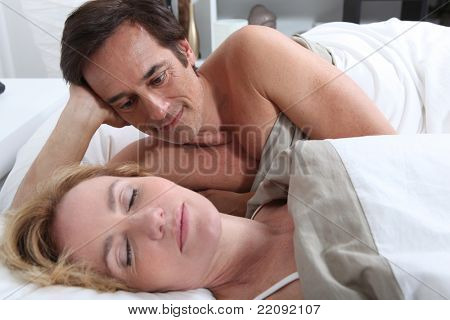 Couple laid in bed together