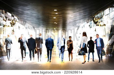 People walking in the city of London. Blurred background with spate for text