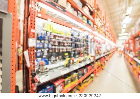 Blurred Cordless Kit And Building Material In Home Improvement Store
