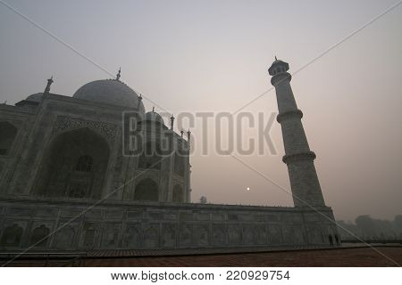 Taj mahal just after sunrise. It can barely be seen due to the high air polution in the Agra area.