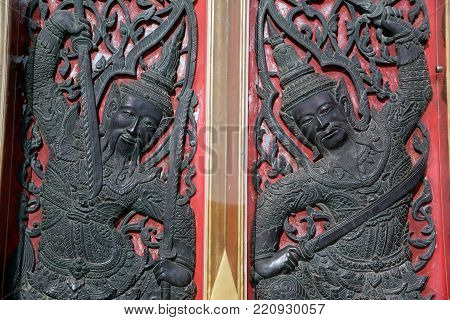 BANGKOK , THAILAND - DEC 19, 2017 : Guardian sculpture on entrance door of Church at Wat Benchamabophit, One of Bangkok's most beautiful temples is also known as