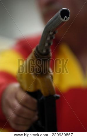 Gasoline pistol at gas station close up view