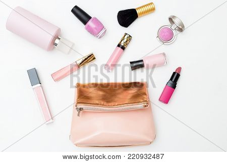 Cosmetics of pink color on a white background. Flat lay