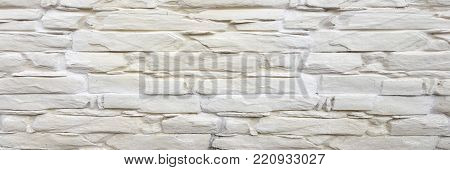Grungy painted stone wall texture as background. Cracked concrete vintage block stone wall background, old painted wall. Background wall painting