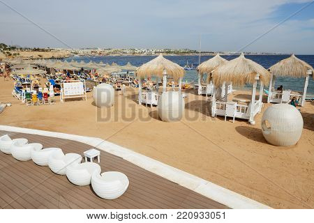 SHARM EL SHEIKH, EGYPT -  NOVEMBER 30: The tourists are on vacation at popular hotel on November 30, 2013 in Sharm el Sheikh, Egypt. Up to 12 million tourists have visited Egypt in year 2013.