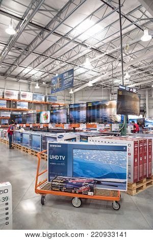 Costco Wholesale With Row Of Big Screen, Smart Tvs Display