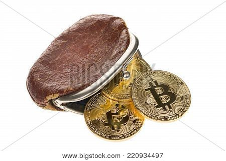 Bitcoin cryptocurrency falling out of vintage money brown purse isolated on white background. Crypto currency electronic money for web banking and international network payment. Selective focus.