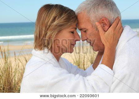 couple of mature people meditating