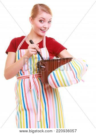 Happy housewife or chef in colorful kitchen apron with pot of soup and ladle isolated studio shot