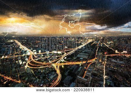 Night scene cityscape traffic with rain storm and thunderbolt lightning in Bangkok metropolis Thailand