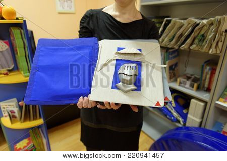 ST. PETERSBURG, RUSSIA - NOVEMBER 22, 2016: Staff of the St. Petersburg state library for the blind and visually impaired people demonstrating the book during the interactive program Tactile Library