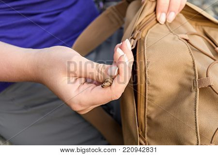 Women's Hands Button Down The Zipper On The Backpack Sand Color Photographed In Close-up