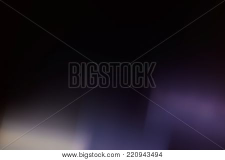 Shimmering light trails on a black background closeup at the bottom of the frame, background, concept for design