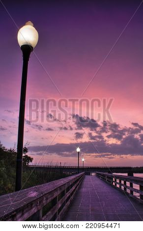 Pier on the Satilla River at dusk at the city of Woodbine, south east Georgia.