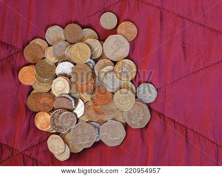 Pound Coins, United Kingdom Over Red Velvet Background