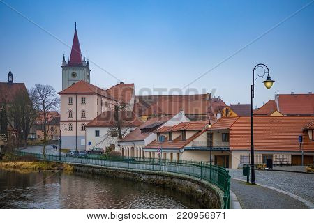 Small town Blatna on embankment of river Lomnice in evening time, Czech Republic