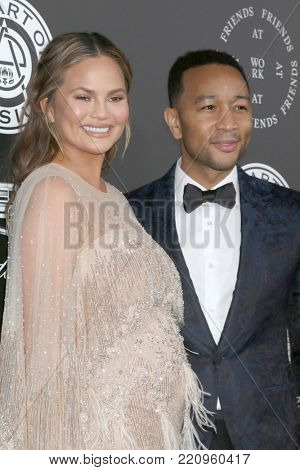 LOS ANGELES - JAN 6:  Chrissy Teigen, John Legend_ at the The Art of Elysium presents John Legend's HEAVEN at Barker Hanger on January 6, 2018 in Santa Monica, CA