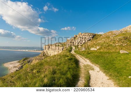 South West Coast Path on the Isle of Portland, looking towards Fortuneswell and Chesil Beach with Weymouth in the background, Jurassic Coast, Dorset, UK