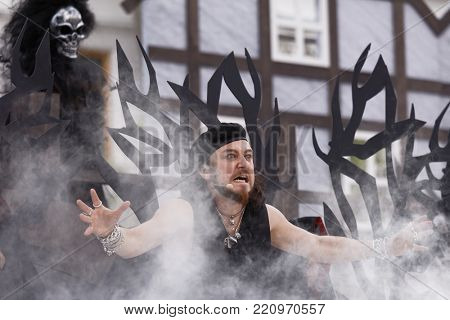 ST. PETERSBURG, RUSSIA - JULY 19, 2017: Pavel Shmulevich in the opera The Marksman of C. M. von Weber outdoors during the festival All Together Opera. It was third of 4 performances