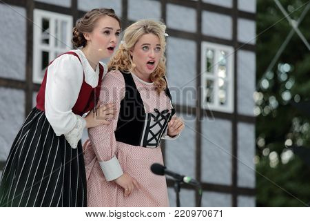 ST. PETERSBURG, RUSSIA - JULY 19, 2017: Micaela di Catalano (right) and Olga Cheremnykh in the opera The Marksman of C. M. von Weber outdoors during the festival All Together Opera