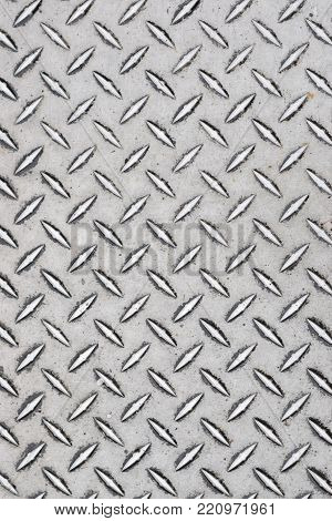 Heavy iron diamond plate abstract close up industrial texture.
