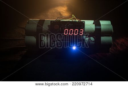 Image Of A Time Bomb Against Dark Background. Timer Counting Down To Detonation Illuminated In A Sha