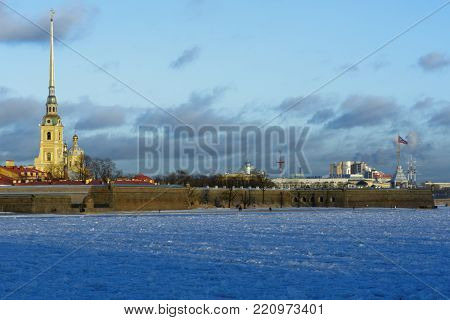 ST. PETERSBURG, RUSSIA - DECEMBER 10, 2016: People walking at St. Peter and Paul fortress along frozen Neva river. Founded in 1703, the fortress was never directly involved in hostilities