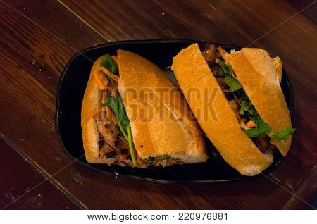 Banh Mi Bread Roll On A Plate. Vietnamese Cuisine Food Background