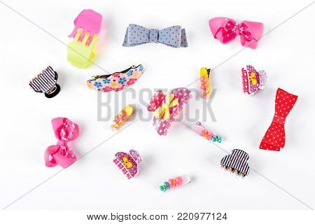 Cute kids hair claws on white background. Hair clips, hairpins, bow tie on white background. Fashion design hair accessories for little girls.