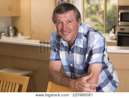 sweet portrait of senior mature middle age man around 70 years old posing happy smiling looking at camera in healthy aging and retirement concept