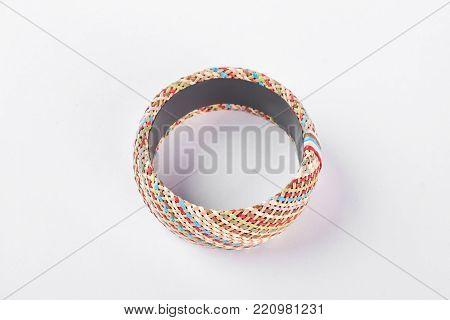 Woman luxury handmade bracelet, top view. Female stylish bangle isolated on white background. Woman fashion accessory on hand.