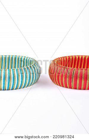 Two colorful bangles on white background. Woman fashion design bracelets isolated on white background. Female stylish hand accessory.