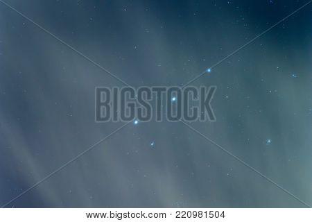 Orion Belt, Cloudy Night sky Background. Night.