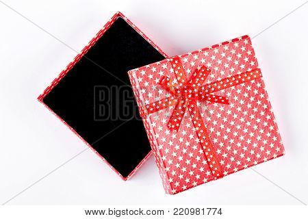 Open red gift box, top view. Opened emptyt red gift box isolated on white background.