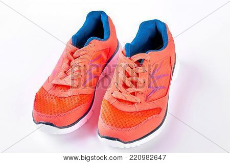 Sport trainers on white background. Female sport shoes isolated on white background. Helathy lifestyle ans sport activity concept.