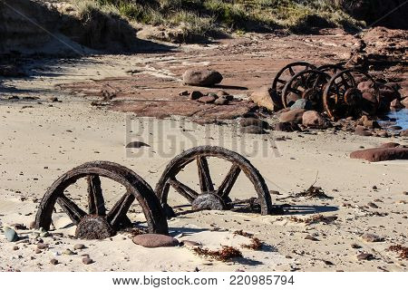 corroded train wheel axle stuck in sand