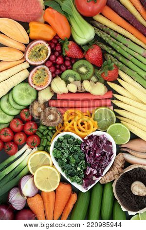 Super food for a healthy diet concept with fresh vegetables and fruit with foods high in anthocyanins, antioxidants, dietary fiber, vitamins and minerals. Top view background.
