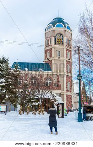 Otaru, Hokkaido, Japan - 30 December 2017 - Tao Clock Tower stands tall and gets ready to chime, one of the main tourist attraction, in Otaru, Hokkaido, Japan on December 30, 2017