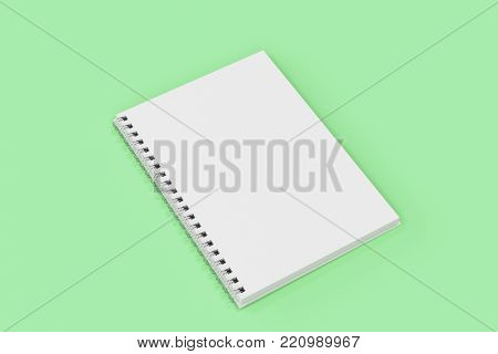 Opend Notebook Spiral Bound On Green Background