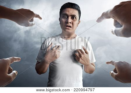 Young asian man accused on smoke background