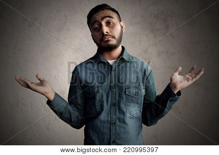 Asian man confused and ignore problem expression