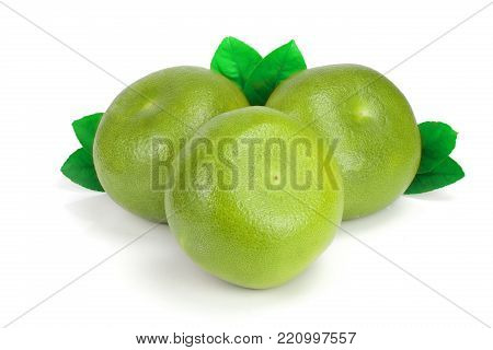 Citrus Sweetie or Pomelit, oroblanco with leaf isolated on white background close-up.