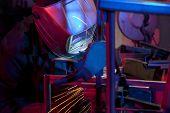 Welder erecting technical steel. Industrial steel welder in factory technical poster